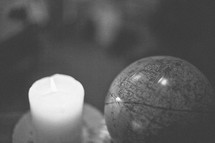A candle and a globe.