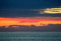 vibrant orange sky at sunset over the ocean