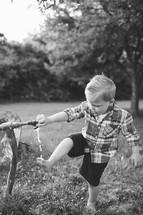 little boy washing his feet outdoors