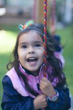 A little girl on a swing