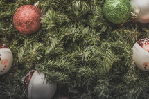 Christmas ornaments in greenery