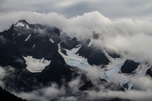 clouds over rugged mountains