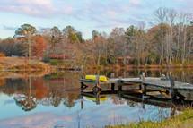 a canoe on a dock in fall