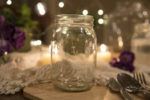 mason jar glass and silverware on a table