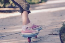 feet of a girl on a ripstick