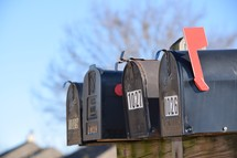 row of mailboxes in a neighborhood