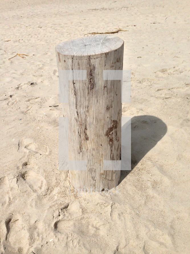 Post in the sand.