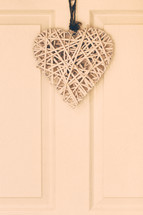 basket weave heart hanging on a door