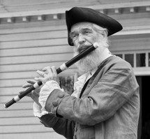 A patriot playing a flute