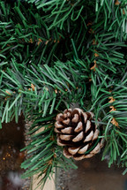 pine cone on an artificial Christmas tree