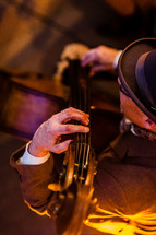Man playing a cello stand up bass jazz cool man with hat