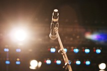 microphone on stage in the spot light
