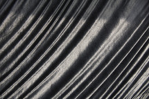 Radiating light and dark lines giving texture