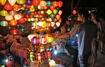 People shopping for Chinese paper lanterns