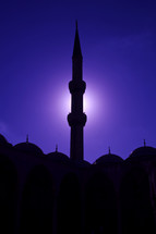 silhouette of a tower on a mosque