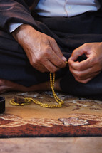 A Chaldean Christian man holding rosary beads.