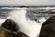 Waves crash on the rocky coast