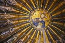 Golden mosaic covered rotunda featuring Christ Jesus his disciples and other saints