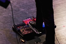 foot on guitar pedals
