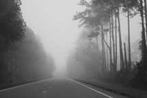 Foggy open road