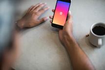 a man opening an Instagram app