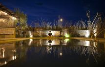 Woman sitting beside a pool
