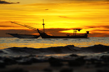 Fishing boats on the sea at sunset