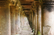 Temple colonnade. Pillars supporting an ancient walkway.
