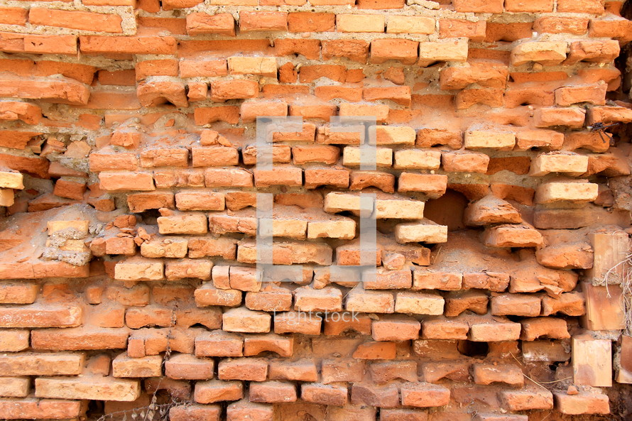 eroded rough brick wall