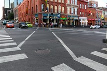 crosswalks and traffic in a downtown street