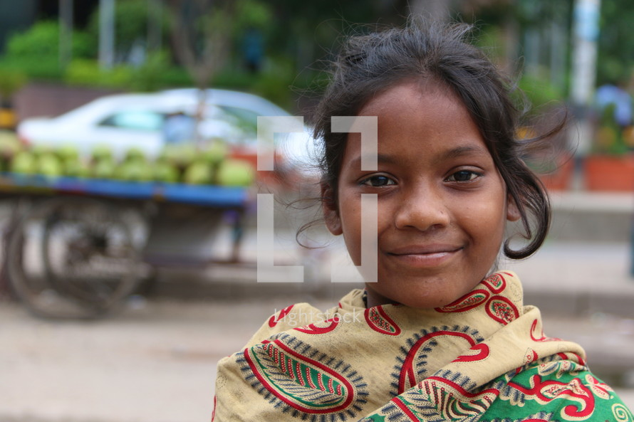 Lower caste Hindu girl in local vegetable market (Try also search for ethnic smile)