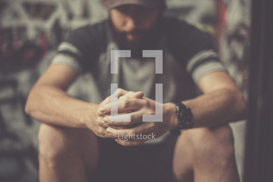 a man sitting in prayer