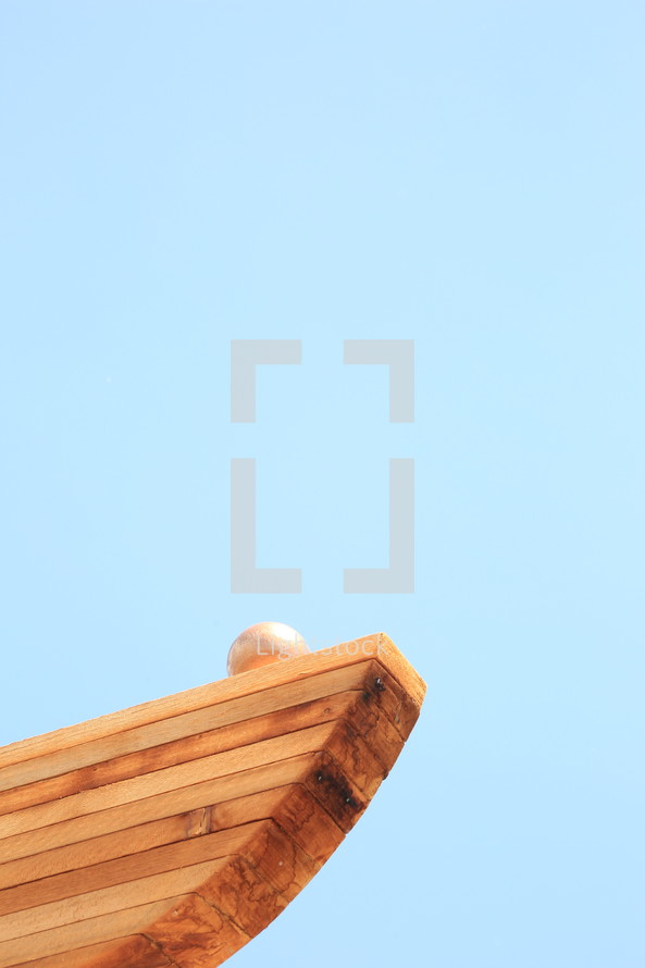 wood boards against a blue sky