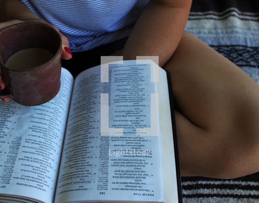 a girl reading a Bible and drinking coffee