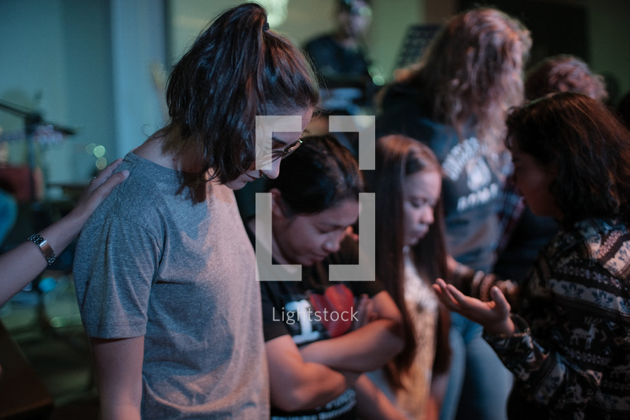 young women praying together