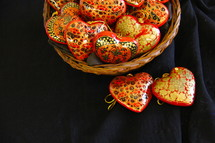 basket of heart shaped hand made wooden ornaments