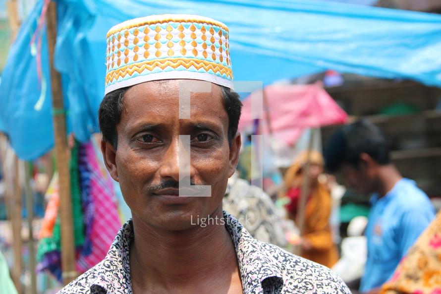 Bangladeshi Muslim man in local market