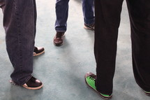 feet of men gathered to have a conversation