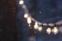snow on a string of lightbulbs