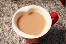 Heart-shaped coffee cup.