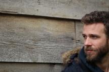 side profile of a bearded man