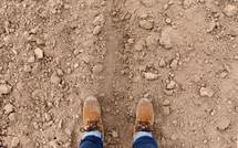a man standing in dirt