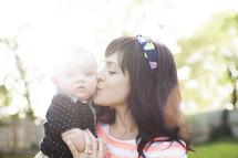 mother kissing her infant son