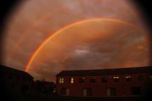 Double rainbow over a building.