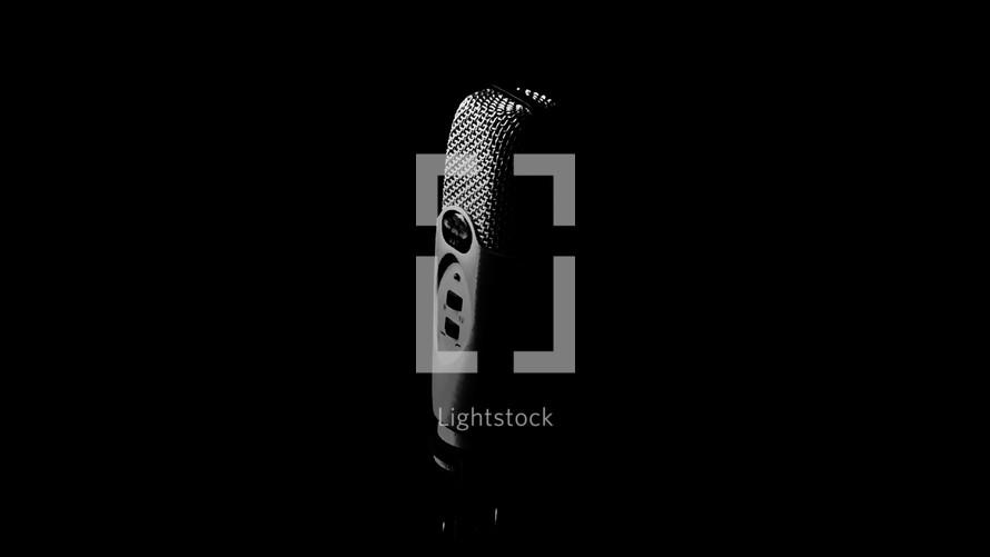 Condenser microphone on black background