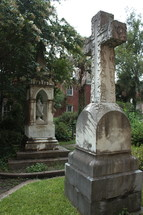 stone cross monument in a cemetery
