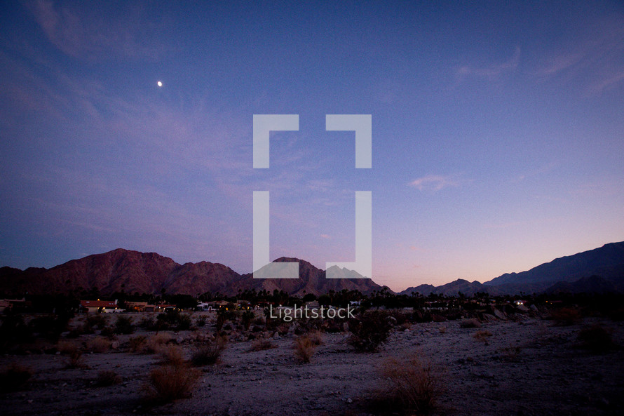 moon over mountains and desert