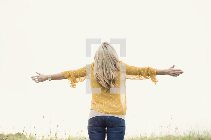 woman standing with open arms
