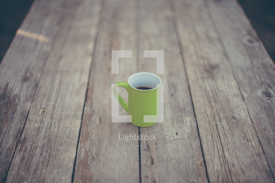 coffee mug on a wood table