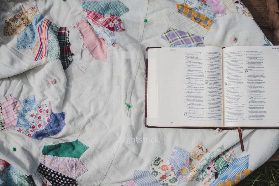 open Bible on a patchwork quilt
